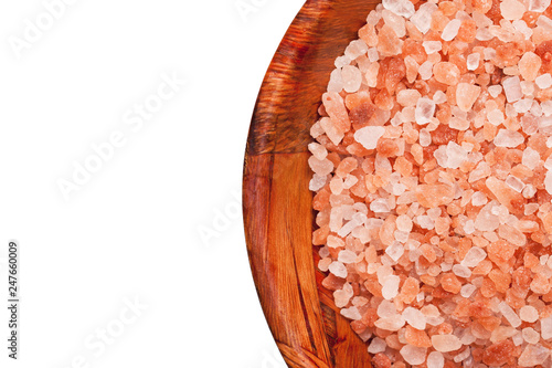 Himalaya salt mineral grains in wooden bowl isolated on