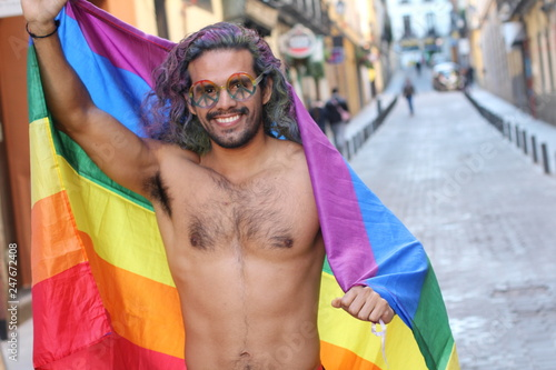 Fotografia  Gay man celebrating diversity with pride