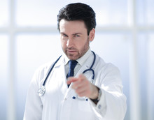 Attentive Doctor Pointing Finger At You