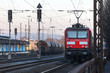 red train on train tracks