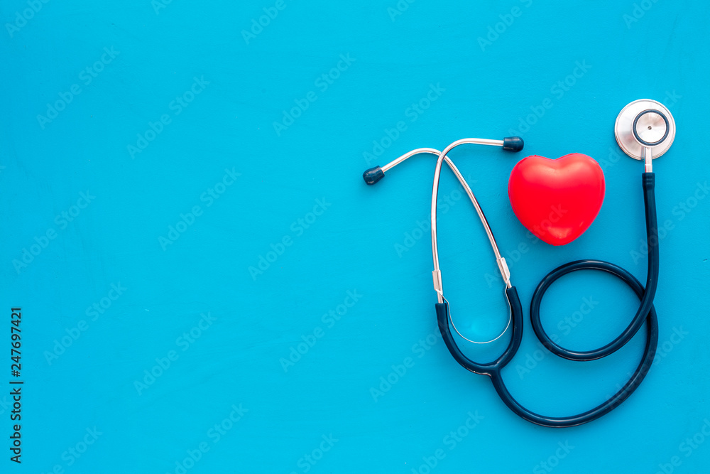 Fototapety, obrazy: Heart health, health care concept. Stethoscope near rubber heart on blue background top view space for text