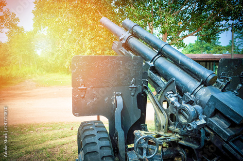 Foto Old artillery cannon gun camouflage pattern / ordnance for soldier warrior in th