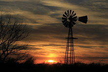 Windmill At Sunset With Clouds...