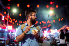 Man Having Ice Cream Rolls In The Night Market
