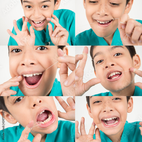 Little boy using dental floss to clean tooth #247728471