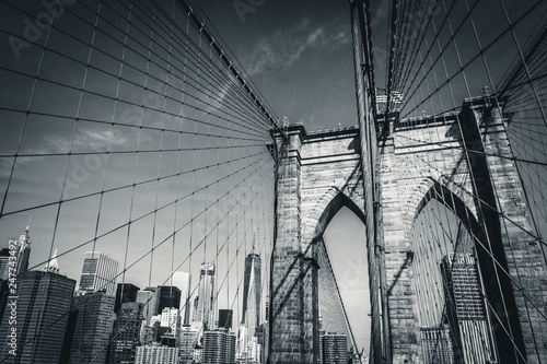Spoed Fotobehang Brooklyn Bridge The Brooklyn Bridge in black and white with the new World Trade Center in the background, New York City, USA