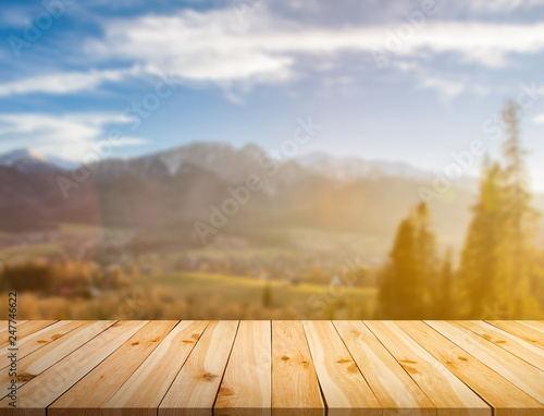 Raw pine planks on bokeh background Wall mural
