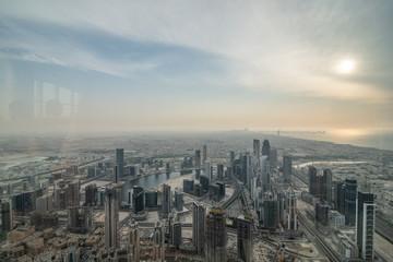 DUBAI, UAE - October, 2018: Top view of Dubai urban skyline from Burj Khalifa. Dubai city view from the top of Burj Khalifa