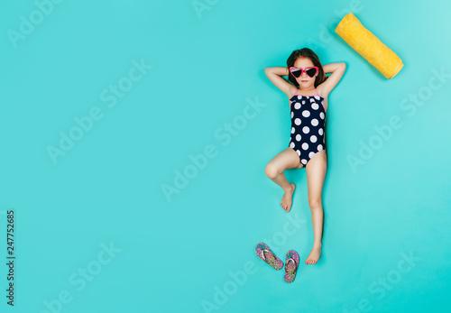 Staande foto Hoogte schaal Cute girl imagining sunbathing on vacation