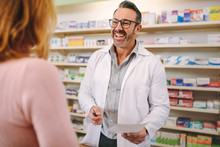 Helpful Pharmacist Dealing With A Woman Customer