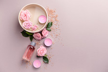 Spa Composition With Candles, Flowers And Essential Oil On Light Background