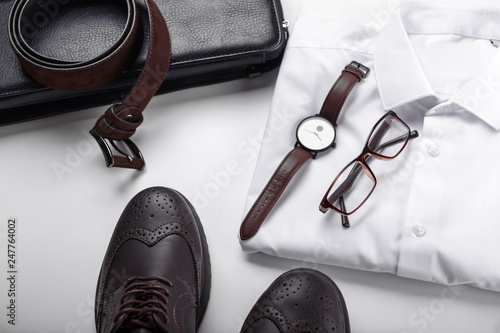Obraz Stylish men's clothes with accessories on white background - fototapety do salonu