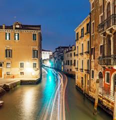 Fototapeta na wymiar Narrow canal street at Early evening blue hour in Venice, Italy