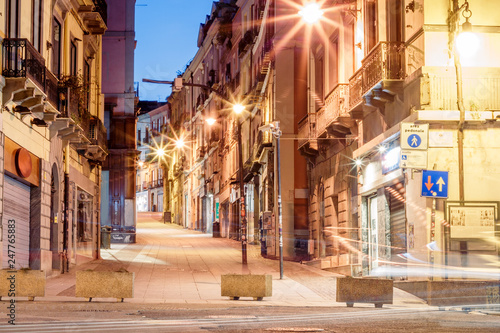 morning streets with lanterns and cafes in Cagliari Italy