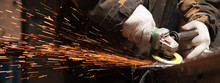 Blacksmith Polishes Metal Products Using A Grinding Machine