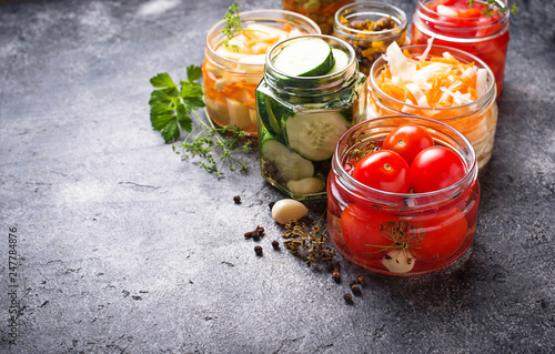 Photo  Fermented food. Preserved vegetables in jars
