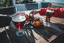 Enjoying Beers And Some Snacks On Spring Afternoon At The Beach
