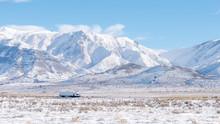 Semi Truck On Snowy Desert Highway