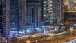 Aerial view of Dubai Tram in Dubai marina night timelapse.