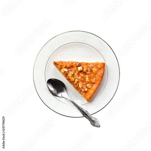 Top view of piece of pumpkin pie with walnuts on a plate isolated on white backg Poster Mural XXL