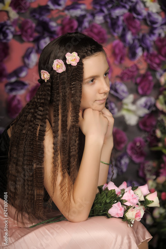 Fényképezés  Long-haired brunette girl. Face, caucasian.