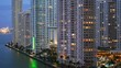 Slow motion pan of downtown Miami lit up in evening