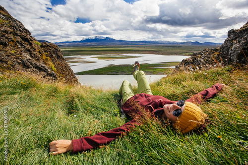 Foto auf AluDibond Pistazie Happy young woman in bright clothes traveling Iceland, enjouing nature