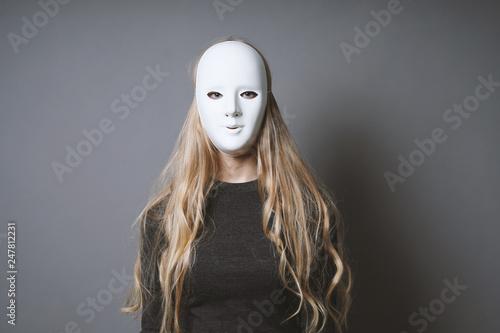 Fényképezés  mysterious woman hiding face and identity behind plain white mask - lack of emot
