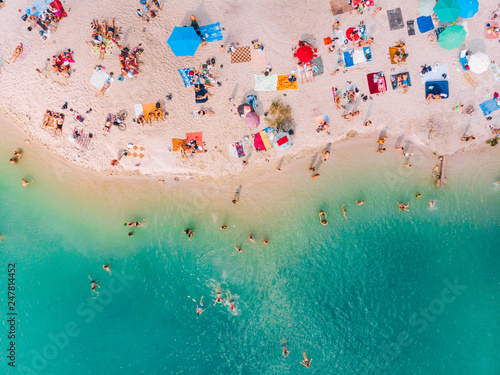 aerial view of sunny sandy beach with blue azure water Fototapeta
