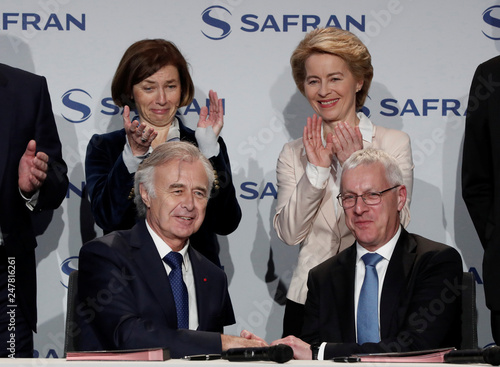 Safran Chief Executive Philippe Petitcolin shakes hands with