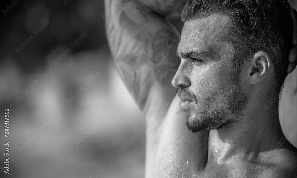 Fototapety, obrazy: Portrait of a handsome caucasian male model posing on the beach