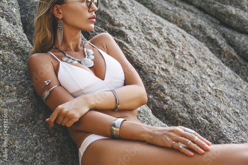 Model in white bikini and wearing boho jewellery Canvas Print