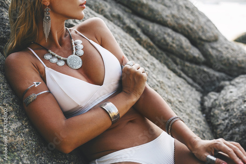 Obraz Model in white bikini and wearing boho jewellery - fototapety do salonu