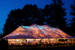 canvas print picture - Wedding tent at night - Special event tent lit up from the inside with dark blue night time sky and trees