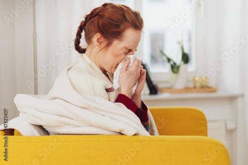 Unwell young woman with a seasonal cold