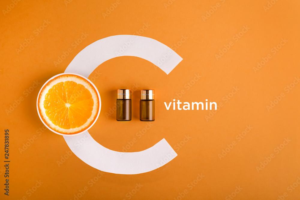 Fototapeta Serum and cosmetics with vitamin C. Essential oil from citrus fruits.