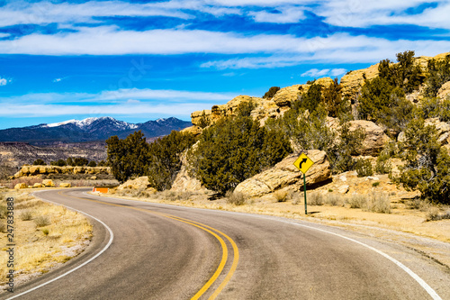 Old Route 66 passing natural rock formations near Cubero, New Mexico in Cibola county