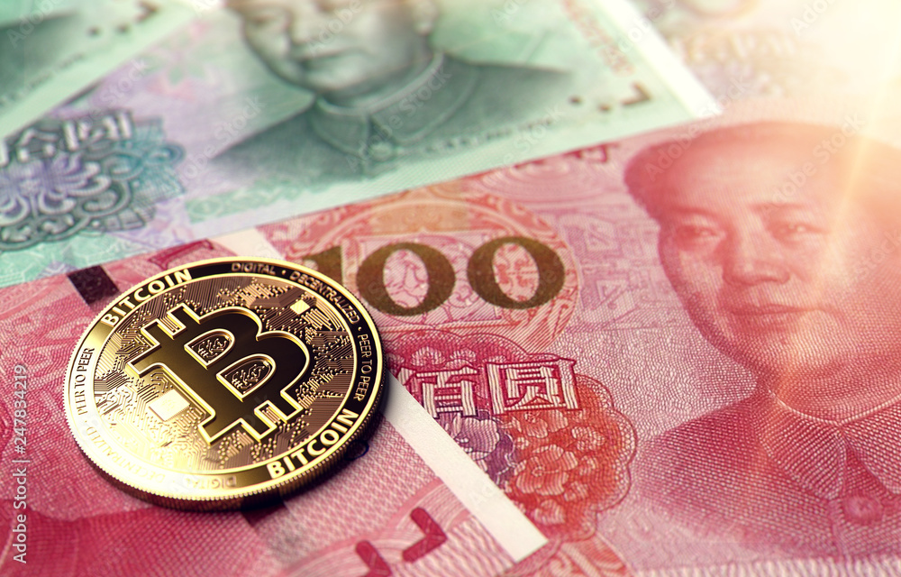 Photo & Art Print Bitcoin coin on Chinese Yuan bills | EuroPosters