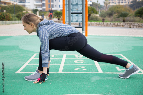Serious athlete stretching hip muscles