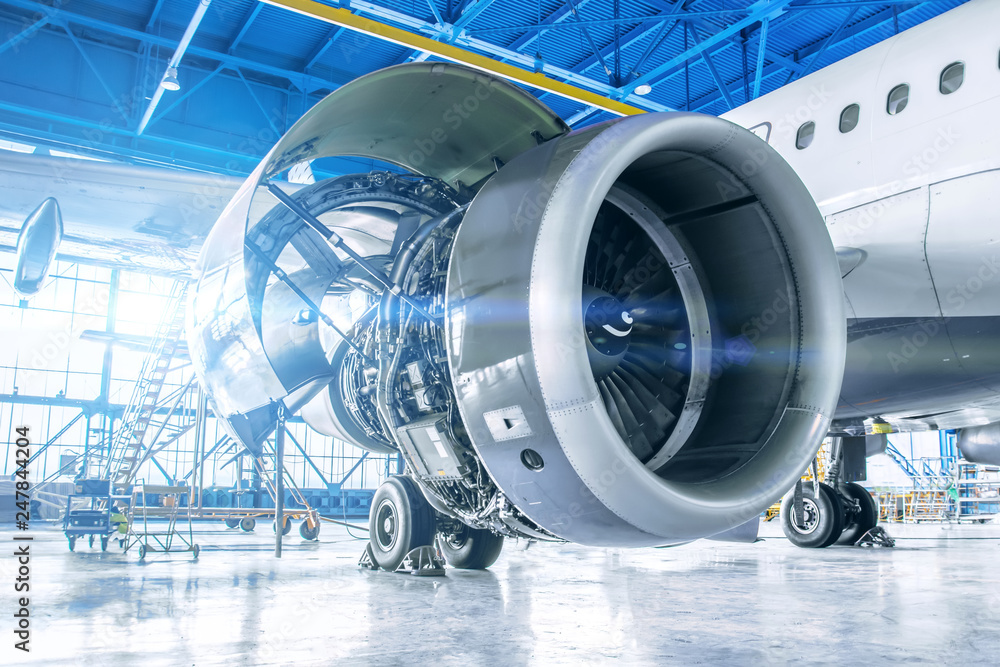 Fototapety, obrazy: Industrial theme view. Repair and maintenance of aircraft engine on the wing of the aircraft.