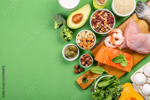 Fotografie, Obraz  Mediterranean diet concept - meat, fish, fruits and vegetables on bright green b