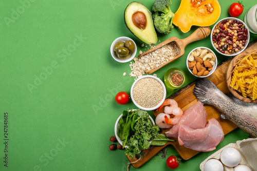 Mediterranean diet concept - meat, fish, fruits and vegetables on bright green b Poster Mural XXL