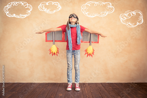 Fotografie, Obraz  Happy child playing with toy jet pack