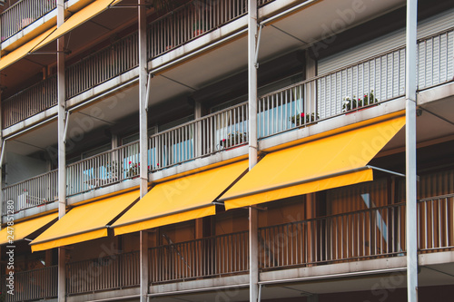Fotografie, Obraz Nice balcony with yellow awning in apartment house.