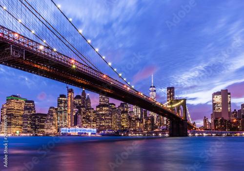Brooklyn Bridge with skyscrapers background. New York City, USA. Brooklyn Bridge is linking Lower Manhattan to Brooklyn..