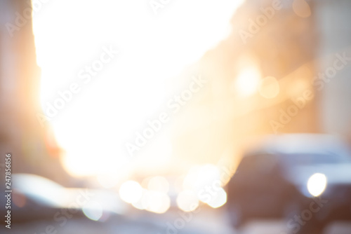 Fotografiet  Abstract blurred yellow background with sunrise and transport in the city