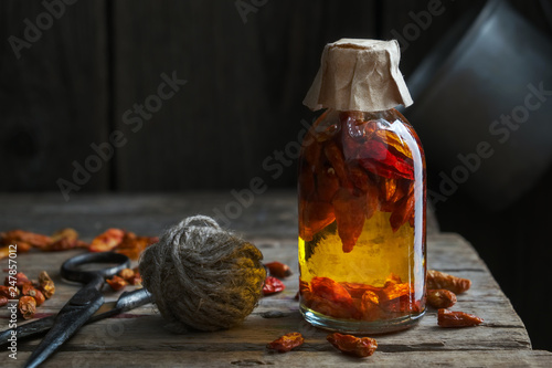 Bottle of red chili pepper infusion or oil.