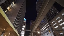 Tracking In On The Skyscrapers And People Mover Of Detroit At Night.