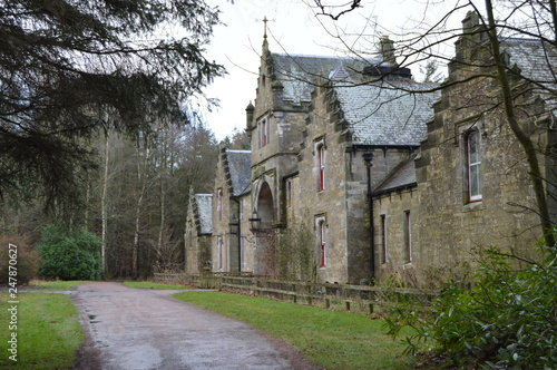 The refurbished stable block at the entrance to the striking ruins of Crawford Priory, Springfield, Cupar, Fife Canvas Print