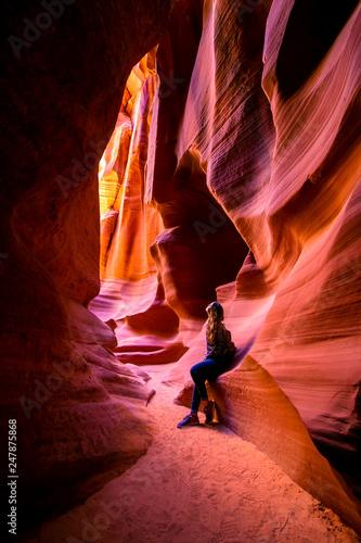 Foto op Aluminium Antilope Impressed young traveler woman looking up inside of the Antelope Canyon, Arizona, USA.